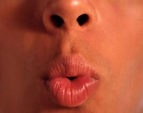 lips pursed together to form an ooh sound